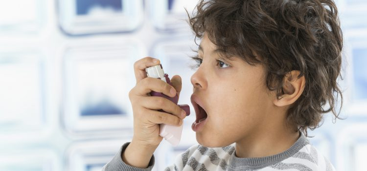 How is asthma caused?